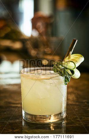 cucumber lemon mint vodka cocktail drink in modern bar