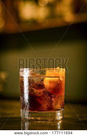 campari orange soda cocktail drink in modern bar