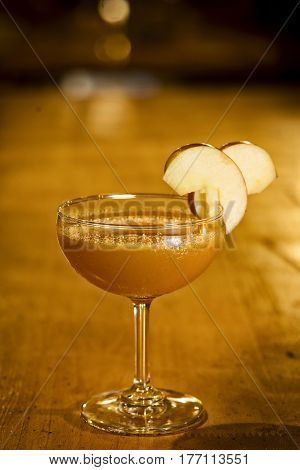 apple margarita cocktail drink in modern bar