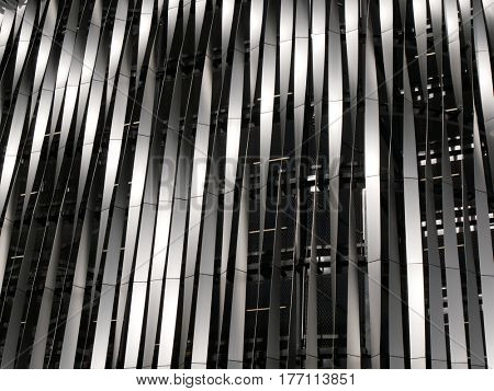 A closeup of a section of a metal facade on modern city building.