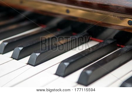 Close up of dusty keys of a piano keyboard