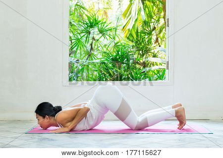 Women Exercise With Yoga In The Room.