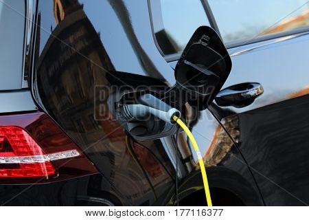 hybrid car charging power on the street