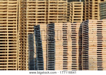 new brown wooden pallets on factory backyard
