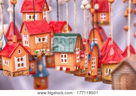 Famous handicraft mart Kaziukas in Vilnius, Lithuania: ceramic houses poster