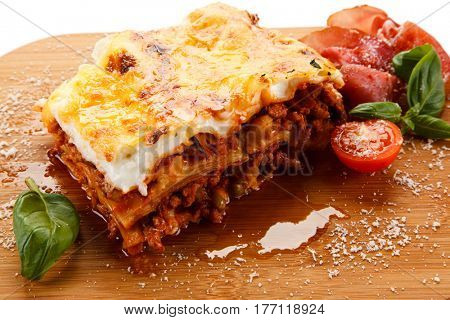 Lasagna on cutting board