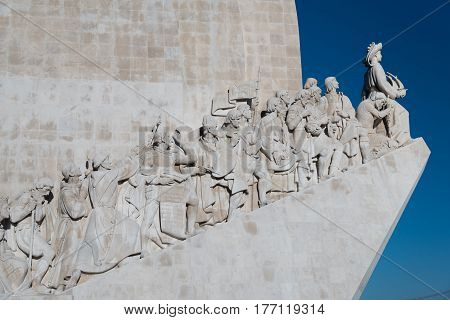 Close up shot on Padrão dos Descobrimentos (Monument to the discoveries) with the focus on the figures from the Portuguese Age of Discoveries on the west side, Santa Maria de Belém, Lisbon, Portugal