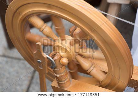 Homemade spinning wheel in action, Vilnius, Lithuania