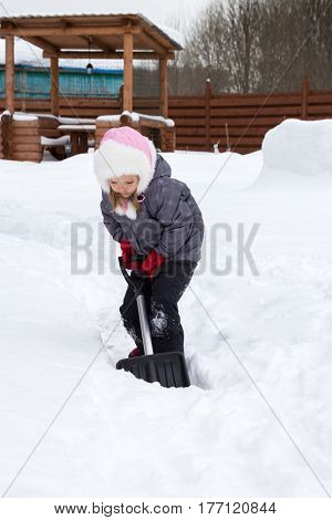 Girl Takes Snow Off The Track With A Shovel