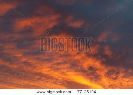 Fiery vivid sunset sky clouds scape background