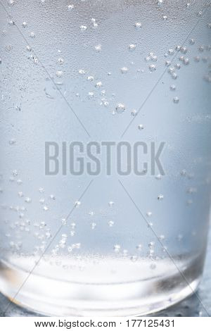 Glass of water close up as background