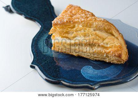 Apple turnover pastry on blue ceramic platter