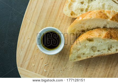 Sliced bread on cutting board with oil top view