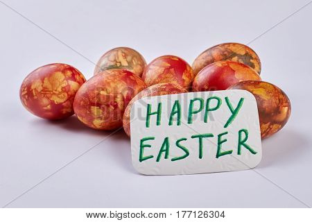 Dyed eggs and Easter card. Christian holiday congratulation.