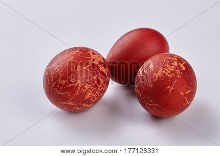 Eggs on white background. Dark red easter eggs. Symbol of spring holiday.