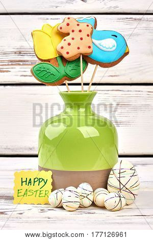 Vase and styrofoam Easter eggs. Cookies and greeting card. Bouquet for a sweet tooth.