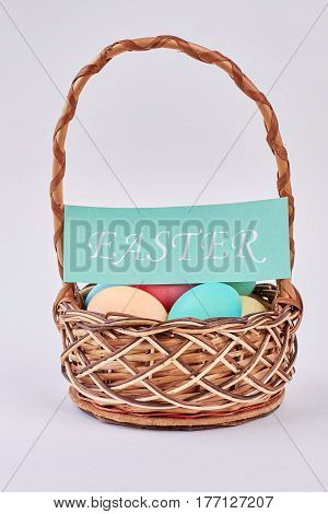 Basket, Easter eggs and card. Easter basket isolated. He is risen.