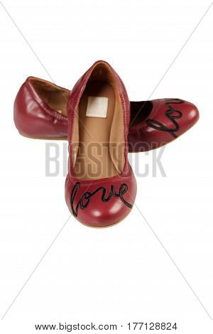Red Ballet flats isolated on white shot in a studio