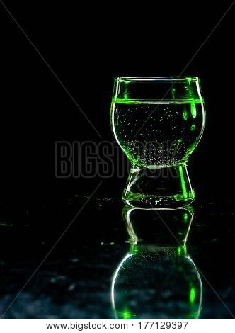 Glass Shined With Colored Light On A Black Background.