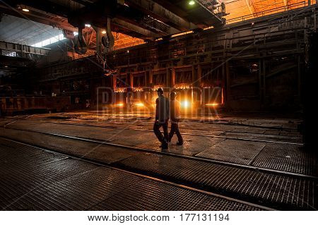 Steelworkers near the working open hearth furnace