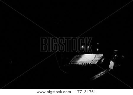 black and white Keyboard and sheet music