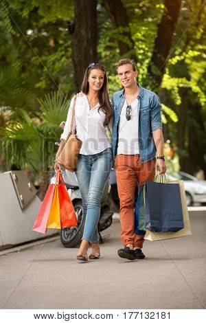 shopping couple outdoor with shopping bags
