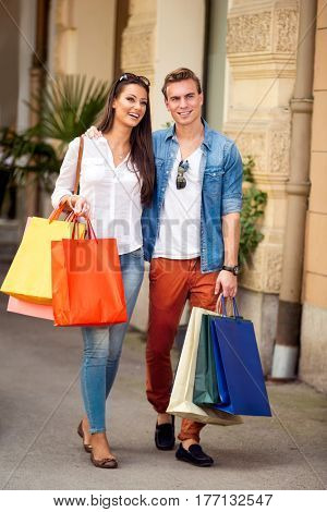 Elegant young couple with shopping bags