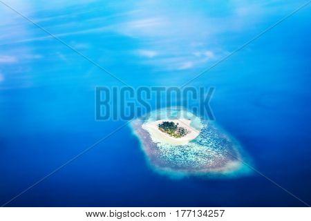Heart shape island in Maldives, Indian Ocean. Aearial view.