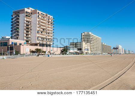 VIRGINIA BEACH, VIRGINIA - AUGUST 09, 2015: Oceanfront hotels, restaurants and attractions along the 3-mile Virginia Beach boardwalk, a popular tourist destination.