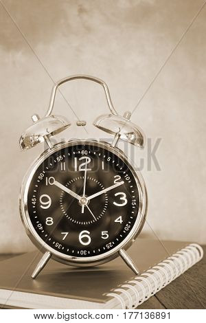 Alarm Clock On Wooden Work Table Old Style