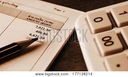 Save money concept Utility bill with pencil and calculator on paper bill background