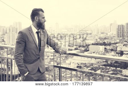 Business Man Glancing City View