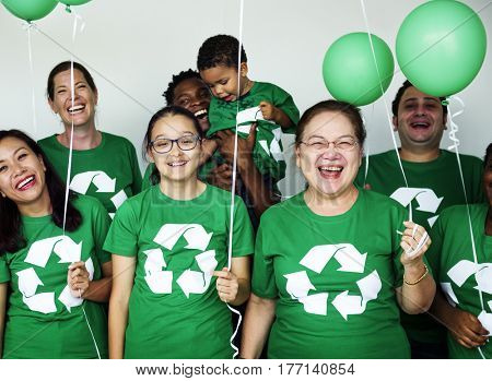 Ecology group of people smiling and holding balloons