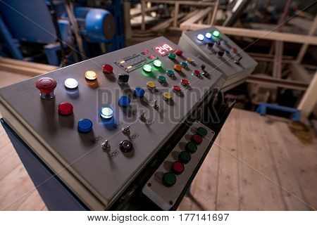 Woodworking machine control panel at a production plant close up view