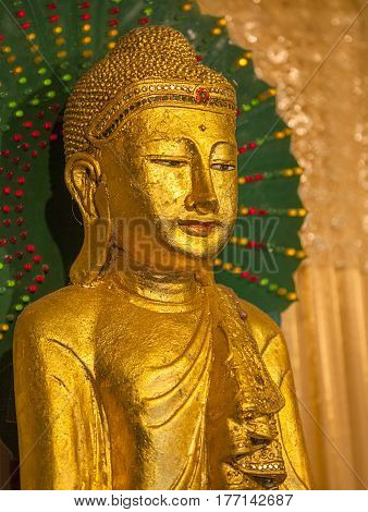 Gold Plated Antique Myanmar style Shakyamuni Buddha statue. Gautama Buddha also known as Siddhartha Gautama Shakyamuni or simply the Buddha was a sage on whose teachings Buddhism was founded.