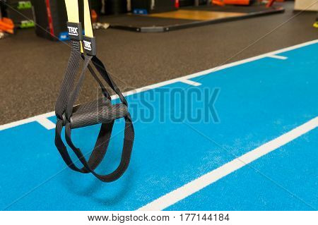Equipment commonly used for crossfit training at fitness club. suspension training trx