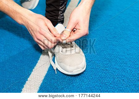 healthy lifestyle sports men tying shoelace on wooden boardwalk sunrise seaside