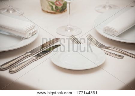 detail of a dining table set up with wine glasses.