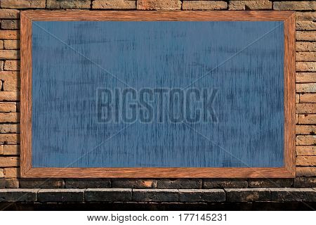 Chalkboard wood frame with black surface on old vintage brick wall background blackboard texture with copy space for educational or business background.