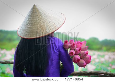 Asian Woman In Traditional Dress With Lotus Flower