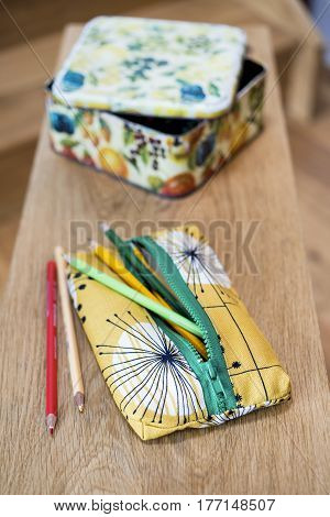 Pencil Case, Pencils And Square Tin On Wooden Plank