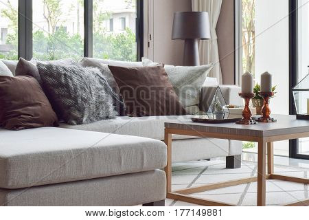 Classic Sofa Set And Wooden Frame Table With Candle On Candle Stick