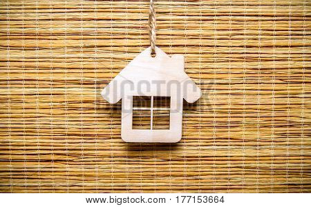 House symbol on a beige background of bamboo