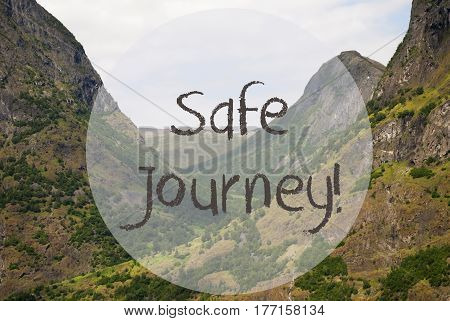 English Text Safe Journey. Valley With Mountains In Norway. Peaceful Landscape, Scenery With Grass, Trees And Rocks.