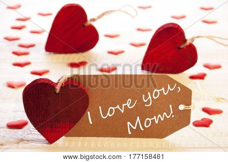 Label With English Text I Love You Mom. Many Red Heart. Wooden Rustic Or Vintage Background.
