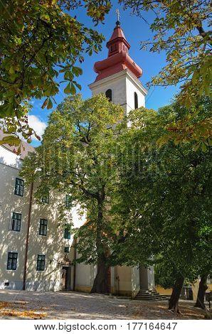 Franciscan Church and Monastery in the shade of chestnut trees - Sumeg (Sümeg), Hungary