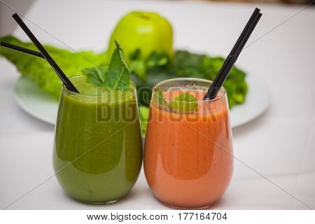 Healthy green and red smoothies and ingredients - superfoods detox diet health vegetarian food concept.
