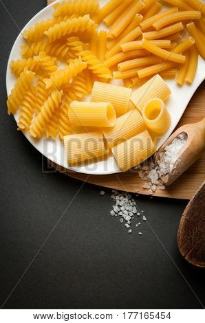 three types of italian pasta on a white plate
