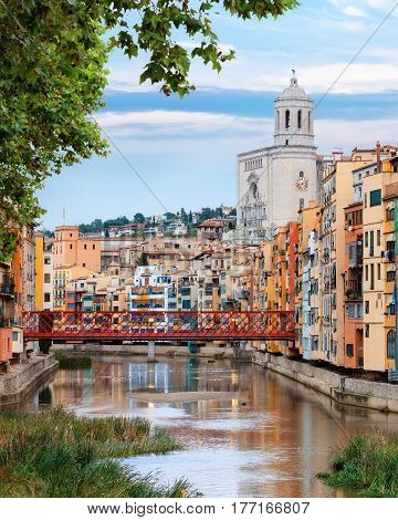 historical jewish quarter in Girona, with Eiffel Bridge at sunrise, Barcelona, Spain, Catalonia