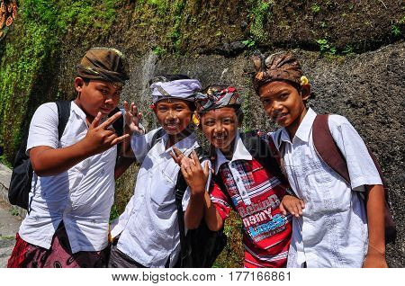 BALI, INDONESIA - SEPTEMBER 27, 2012: Local kids around the Gunung Kawi archaelogical site in Bali Indonesia